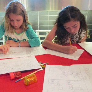 Working on their comic books