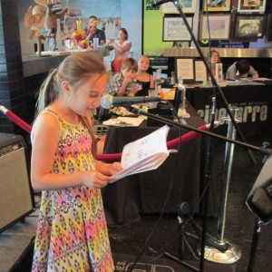 Student reading comic book at Annual Cinebarre Art Show